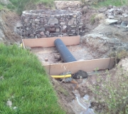 50. Foundation for one of the bridges with a pipe for the existing stream in place.